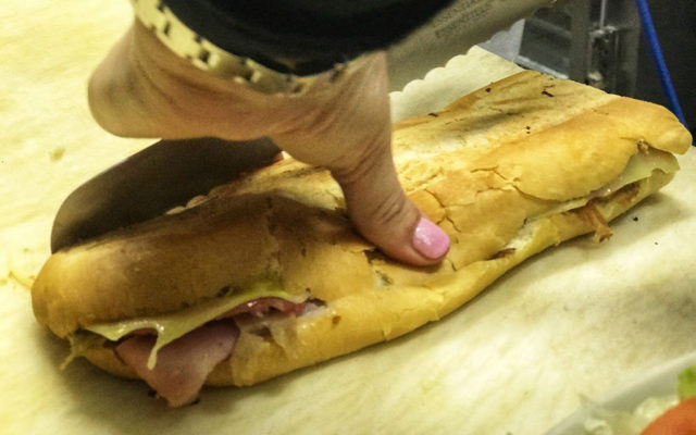 2-1-19-Andrea-Gonzmart-Williams-slicing-Cuban-sandwich-credit-Jeff-Houck 1024x640
